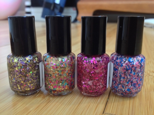 The polishes again in the same order but from the back so you can see all the glittery amazingness