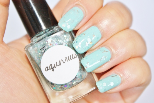 Aquarius is a beautiful blend of matte aqua, iridescent, and holographic glitter in a clear base
