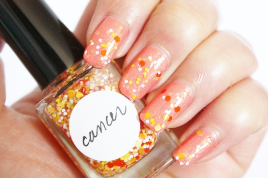 Cancer is a beautiful blend of multi-sized orange, peach, banana yellow, white, and iridescent glitter in a clear base
