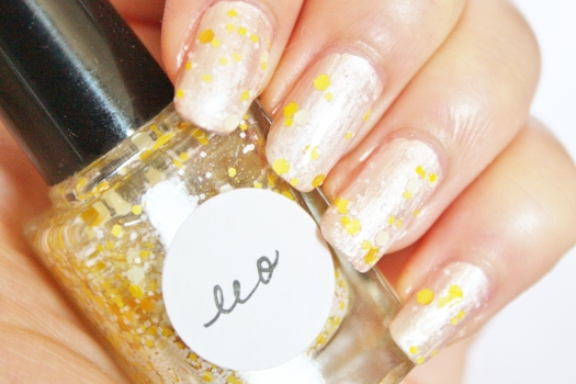 Leo is a beautiful blend of multi-hued shades of yellow, white, and iridescent glitter in a clear base
