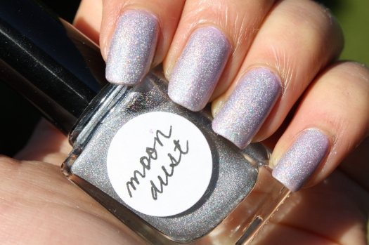 Moondust is a scattered holographic glitter topcoat with a slight linear effect in a clear base