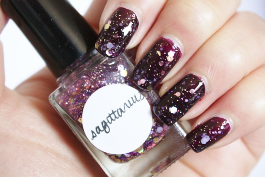 Sagittarius is a beautiful blend of multi-hued purple, pink, gold, and holographic gold glitter in a pink tinted clear base