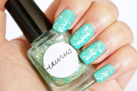 Taurus is a beautiful blend of multi-sized matte aqua, pastel green, fern green, and iridescent glitter in a clear base