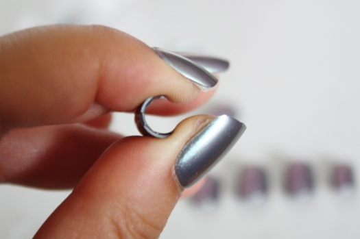 Step 2.5: Roll nails gently between fingers to curve them more to natural nail shape